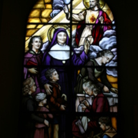 Stained glass window of St Julie and the Sacred Heart